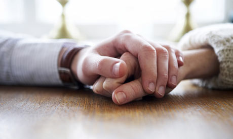 Holding the hand of a dying person